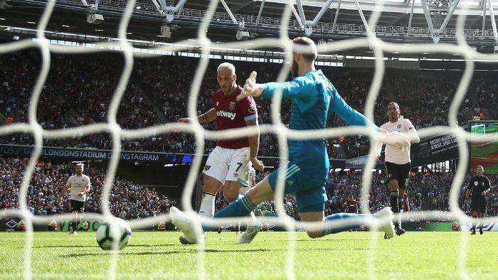 Kiper Manchester United David de Gea mengakui kekalahan atas West Ham di musim lalu masih terbayang di benak timnya. Foto: Warren Little / Getty Images