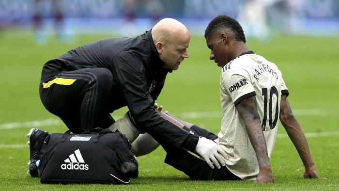 Marcus Rashford dapat cedera saat Manchester United dikalahkan West Ham (Henry Browne/Getty Images)