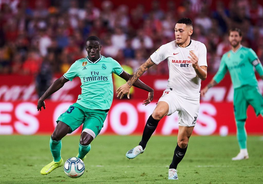SEVILLE, SPAIN - SEPTEMBER 22: Ferland Mendy of Real Madrid CF  duels for the ball with Lucas Ocampos of Sevilla FC during the Liga match between Sevilla FC and Real Madrid CF at Estadio Ramon Sanchez Pizjuan on September 22, 2019 in Seville, Spain. (Photo by Aitor Alcalde/Getty Images)