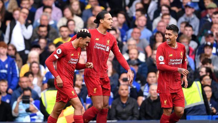 Liverpool berpeluang menyamai dua buah rekor di Liga Inggris dalam laga melawan Manchester United (Foto: Laurence Griffiths/Getty Images)