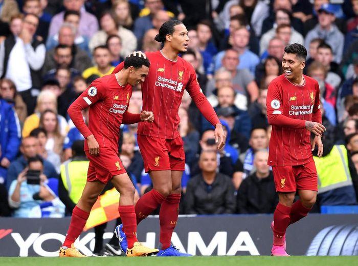Pemain Liverpool merayakan golnya ke gawang Chelsea. (Foto: Laurence Griffiths/Getty Images)
