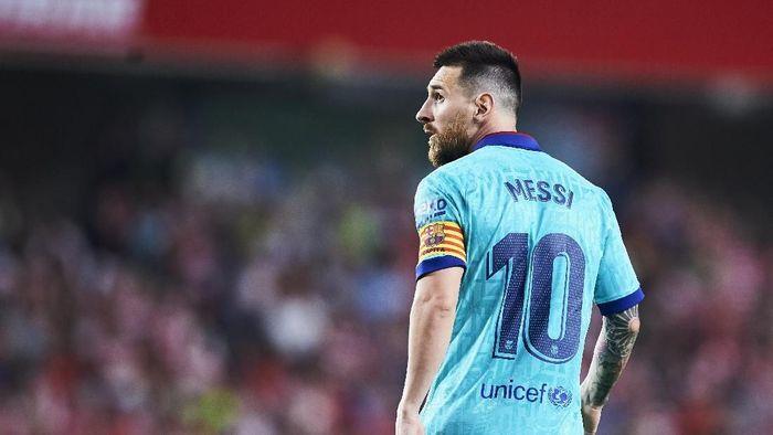 Lionel Messi tak mau mengubah apapun di dalam kariernya demi juarai Piala Dunia. (Foto: Aitor Alcalde/Getty Images)