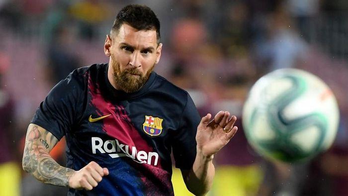 Lionel Messi membidik gelar juara Liga Champions dan Copa America. (Foto: Lluis Gene / AFP)