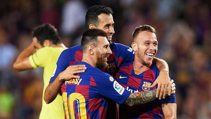 BARCELONA, SPAIN - SEPTEMBER 24: Arthur Melo of FC Barcelona celebrates with his teammates Sergio Busquets and Lionel Messi after scoring his teams second goal during the Liga match between FC Barcelona and Villarreal CF at Camp Nou on September 24, 2019 in Barcelona, Spain. (Photo by Alex Caparros/Getty Images)