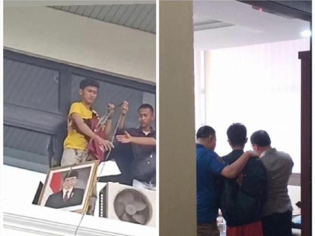Polisi Amankan Mahasiswa yang Turunkan Pigura Foto Jokowi