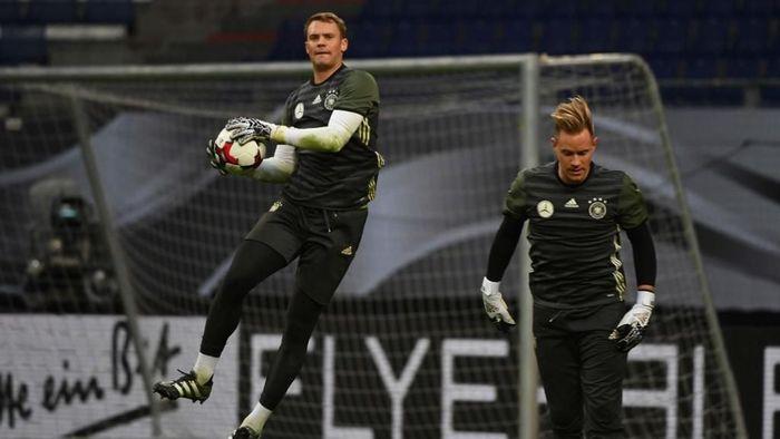 Manuel Neuer membantah hubunganya dengan Marc-Andre Ter Stegen kurang harmonis (Foto: Patrik Stollarz / AFP)