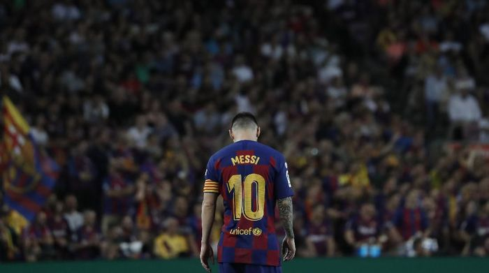 Barcelonas Lionel Messi walks on the pitch during the Spanish La Liga soccer match between FC Barcelona and Villarreal CF at the Camp Nou stadium in Barcelona, Spain, Tuesday, Sep. 24, 2019. (AP Photo/Joan Monfort)