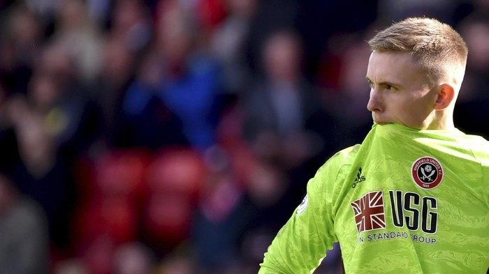 Sheffield Uniteds goalkeeper Dean Henderson reacts during the English Premier League soccer match between Sheffield United and Liverpool at Bramall Lane in Sheffield, England, Saturday, Sept. 28, 2019. (AP Photo/Rui Vieira)