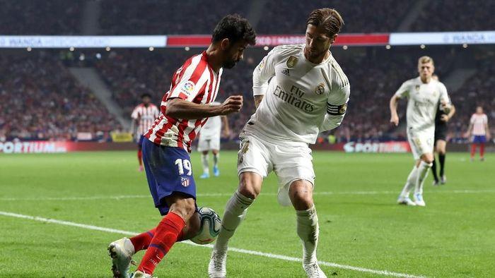 Sergio Ramos tidak puas dengan hasil seri yang didapat Real Madrid di kandang Atletico Madrid (Foto: Angel Martinez/Getty Images)