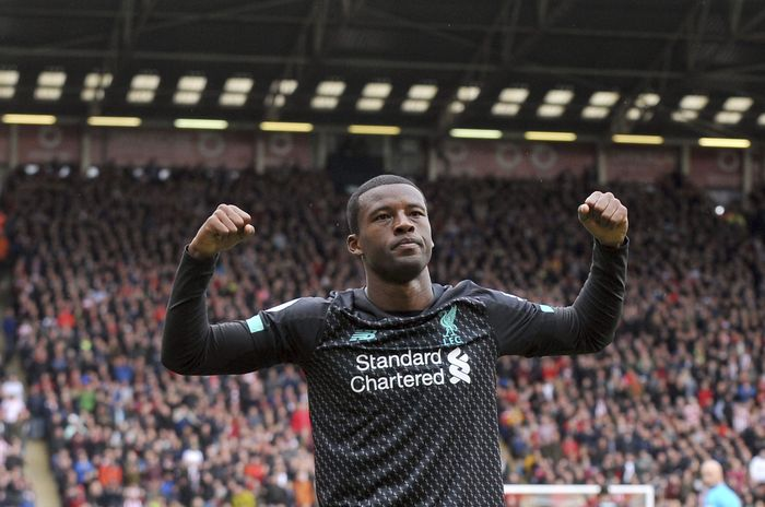 Liverpools Georginio Wijnaldum celebrates after scoring his sides opening goal during the English Premier League soccer match between Sheffield United and Liverpool at Bramall Lane in Sheffield, England, Saturday, Sept. 28, 2019. (AP Photo/Rui Vieira)