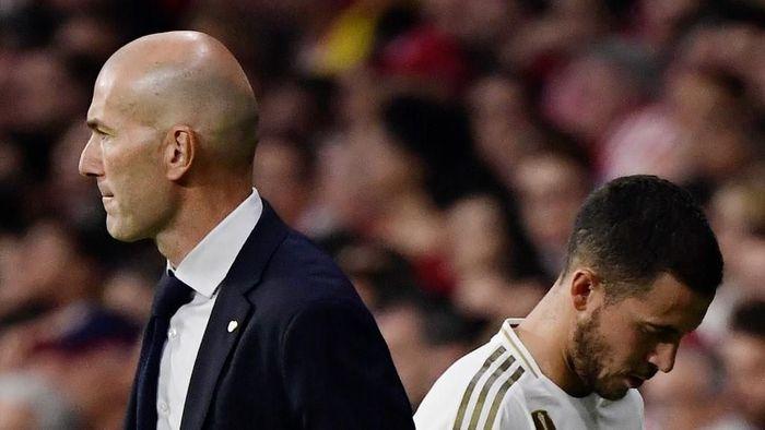 Pelatih Real Madrid Zinedine Zidane tidak risau Eden Hazard belum mengilap. (Foto: Javier Soriano / AFP)