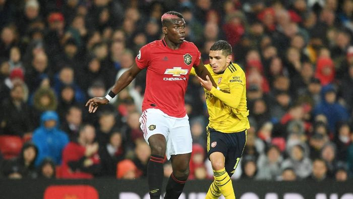 MU vs Arsenal berakhir imbang 1-1. (Foto: Michael Regan/Getty Images)