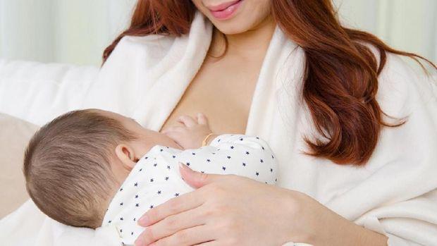 Ilustrasi menyusui bayi