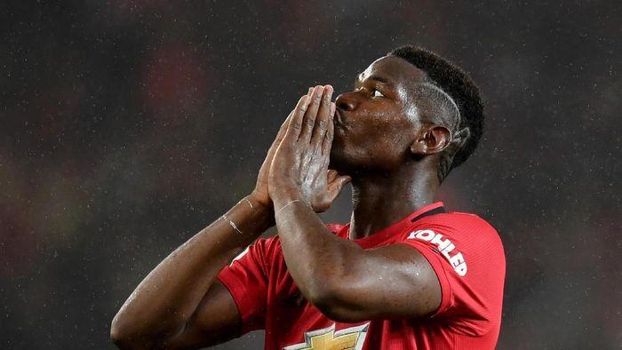MU berimbang 1-1 dengan Arsenal. (Foto: Michael Regan/Getty Images)