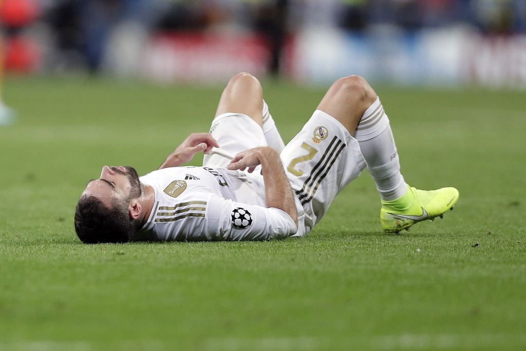 Real Madrid's Dani Carvajal lies on the pitch at the end of the Champions League group A soccer match between Real Madrid and Club Brugge, at the Santiago Bernabeu stadium in Madrid, Tuesday, Oct.1, 2019. (AP Photo/Manu Fernandez)