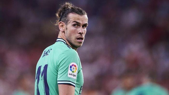 Gareth Bale terlambat datang untuk menyaksikan Real Madrid menjamu Brugge di Liga Champions. (Foto: Aitor Alcalde / Getty Images)