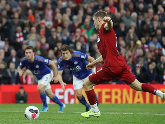 Soccer Football - Premier League - Liverpool v Leicester City - Anfield, Liverpool, Britain - October 5, 2019  Liverpools James Milner scores their second goal from the penalty spot   Action Images via Reuters/Carl Recine  EDITORIAL USE ONLY. No use with unauthorized audio, video, data, fixture lists, club/league logos or live services. Online in-match use limited to 75 images, no video emulation. No use in betting, games or single club/league/player publications.  Please contact your account representative for further details.