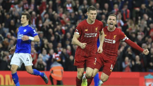Liverpool's James Milner celebrates his wining goal with Liverpool's Jordan Henderson during English Premier League soccer match between Liverpool and Leicester City in Anfield stadium in Liverpool, England, Saturday, Oct. 5, 2019. (AP Photo/Jon Super)