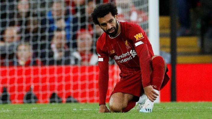 Mohamed Salah absen saat Liverpool tandang ke markas Manchester United di Liga Inggris (Foto: Phil Noble/Reuters)