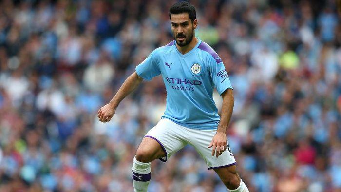 Ilkay Guendogan menyebut Manchester City tidak panik meski tertinggal delapan angka dari Liverpool (Foto: Alex Livesey/Getty Images)