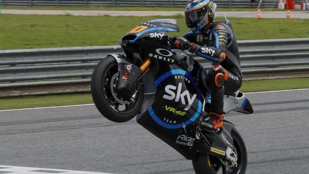 Italy's Moto2 rider Luca Marini of the SKY Racing Team VR46 celebrates during Thailand's Moto2 at the Chang International Circuit in Buriram, Thailand, Sunday, Oct. 6, 2019. (AP Photo/Gemunu Amarasinghe)