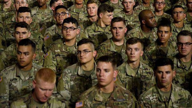 Soldiers wait for US President Donald Trump before a signing ceremony for the ìJohn S. McCain National Defense Authorization Act for Fiscal Year 2019î at Fort Drum, New York, on August 13, 2018. (Photo by Brendan Smialowski / AFP)