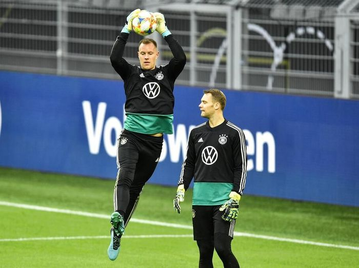 Germanys goalkeepers Marc-Andre ter Stegen, up, and Manuel Neuer, down, exercise during a training session of the national team on Tuesday, Oct. 8, 2019, prior a friendly soccer match between Germany and Argentina in Dortmund, Germany. (AP Photo/Martin Meissner)