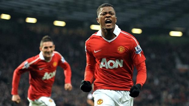 Manchester United's French defender Patrice Evra (R) celebrates scoring his goal during the English Premier League football match between Manchester United and Wigan Athletic at Old Trafford in Manchester, north-west England on November 20, 2010. (AFP PHOTO/ANDREW YATES)