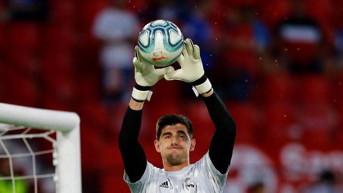 Courtois masih memble di Real Madrid tapi tangguh di Timnas Belgia (REUTERS/Marcelo del Pozo)