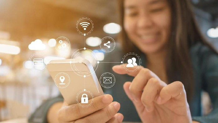 Woman hand using mobile phone with virtual icon diagram. Application connectivity device smartphone technology for convenience of user