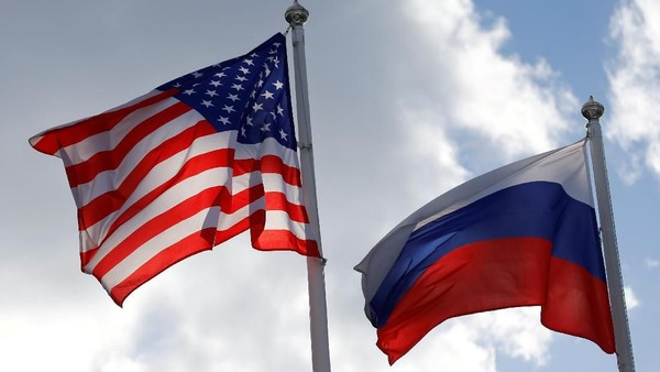 FILE PHOTO: Russian and U.S. state flags fly near a factory of Ford Sollers, a joint venture of U.S. carmaker Ford with Russian partners, in Vsevolozhsk, Leningrad Region, Russia March 27, 2019. REUTERS/Anton Vaganov/File Photo
