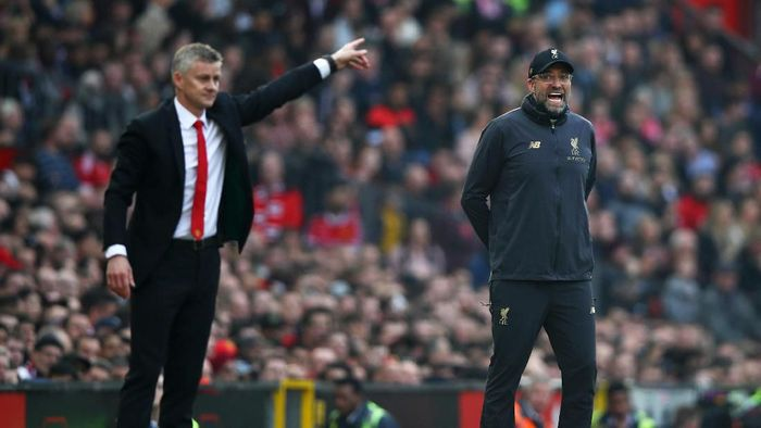 MANCHESTER, ENGLAND - FEBRUARY 24:  Jurgen Klopp, Manager of Liverpool and Ole Gunnar Solskjaer, Interim Manager of Manchester United react during the Premier League match between Manchester United and Liverpool FC at Old Trafford on February 24, 2019 in Manchester, United Kingdom.  (Photo by Clive Brunskill/Getty Images)