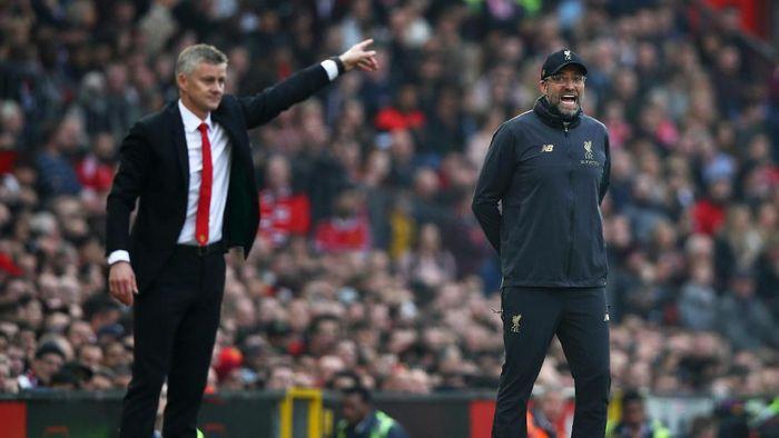 Manajer Liverpool Juergen Klopp tak punya saran untuk Ole Gunnar Solskjaer untuk membangkitkan Man United. (Foto: Clive Brunskill / Getty Images)