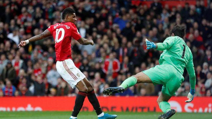MU vs Liverpool tuntas 1-1. (Foto: Russell Cheyne/REUTERS)