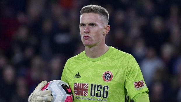 Sheffield United's goalkeeper Dean Henderson holds the ball during the English Premier League soccer match between Sheffield United and Arsenal at Bramall Lane in Sheffield, England, Monday, Oct. 21, 2019. (AP Photo/Rui Vieira)