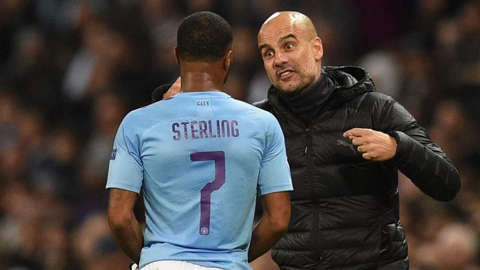 Manchester Citys Spanish manager Pep Guardiola (R) talks with Manchester Citys English midfielder Raheem Sterling (L) during the UEFA Champions League Group C football match between Manchester City and Atalanta at the Etihad Stadium in Manchester, northwest England on October 22, 2019. (Photo by Oli SCARFF / AFP)