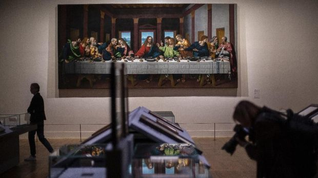 The Last Supper by Leonardo da Vinci displayed at the Louvre museum Sunday, Oct. 20, 2019 in Paris. A unique group of artworks is displayed at the Louvre museum in addition to its collection of paintings and drawings by the Italian master. The exhibition opens to the public on Oct.24, 2019. (AP Photo/Rafael Yaghobzadeh)