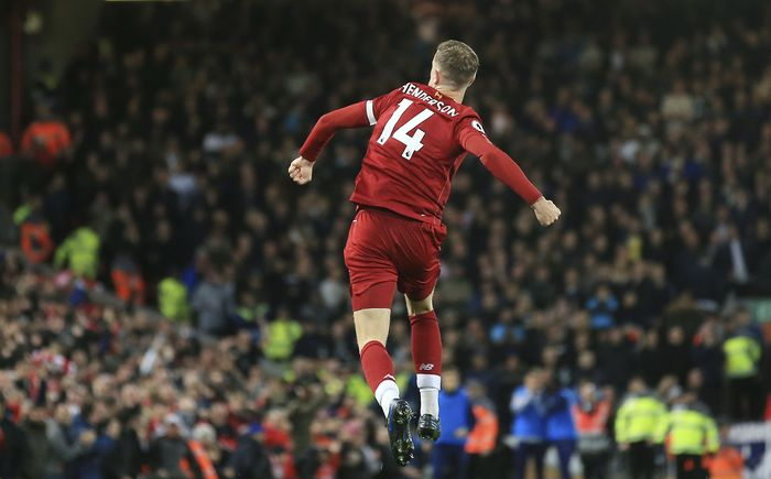 Liverpools Jordan Henderson celebrates after scoring his sides opening goal during the English Premier League soccer match between Liverpool and Tottenham Hotspur at Anfield stadium in Liverpool, England, Sunday, Oct. 27, 2019. (AP Photo/Jon Super)