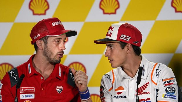 MotoGP rider Marc Marquez of Spain, right, speaks to Italy's rider Andrea Dovizioso of the Ducati Team during a press conference at Sepang International Circuit ahead of the MotoGP Malaysian Grand Prix in Sepang, Thursday, Oct. 31, 2019. (AP Photo/Vincent Thian)
