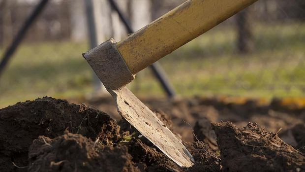 Close up shot of hoe in soil