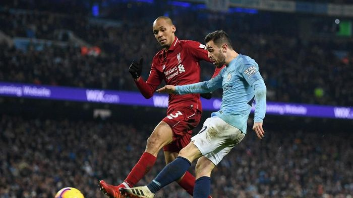 Fabinho tak yakin jika Liverpool kalahkan Man City bakal memuluskan jalan juara Liga Inggris (Shaun Botterill/Getty Images)
