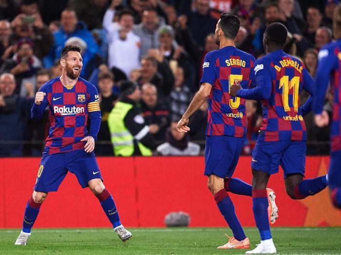 Lionel Messi dan skuat Barcelona. (Foto: Alex Caparros/Getty Images)