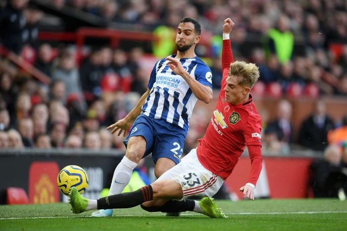 MANCHESTER, ENGLAND - NOVEMBER 10: Brandon Williams of Manchester United tackles Martin Montoya of Brighton and Hove Albion during the Premier League match between Manchester United and Brighton & Hove Albion at Old Trafford on November 10, 2019 in Manchester, United Kingdom. (Photo by Michael Regan/Getty Images)