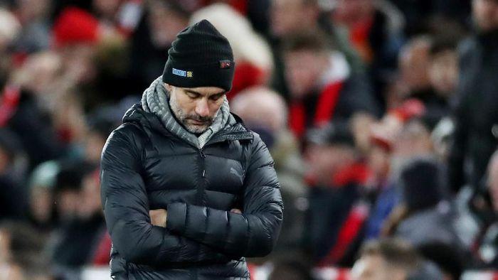 Manajer Man City Pep Guardiola mengukir rekor poin terburuk dalam 12 pertandingan di suatu kompetisi liga. (Foto: Carl Recine / Action Images via Reuters)