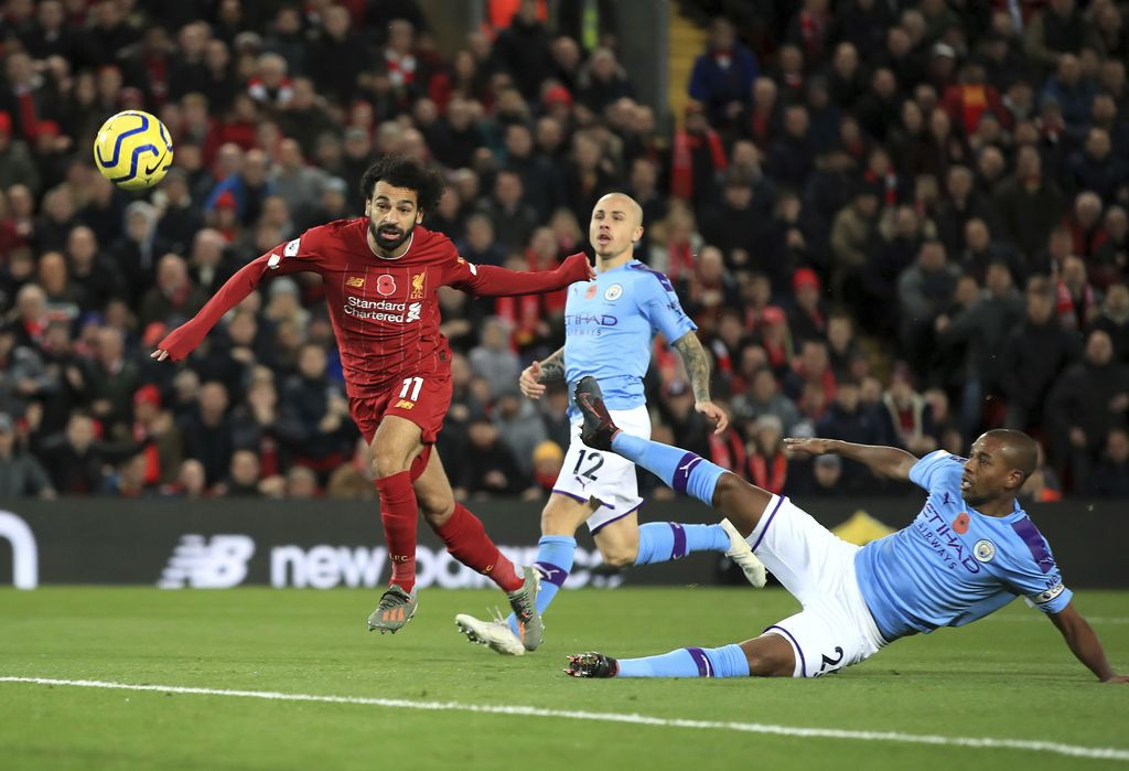 Liverpool's Mohamed Salah, left, celebrates after scoring his side's second goal during the English Premier League soccer match between Liverpool and Manchester City at Anfield stadium in Liverpool, England, Sunday, Nov. 10, 2019. (AP Photo/Jon Super)
