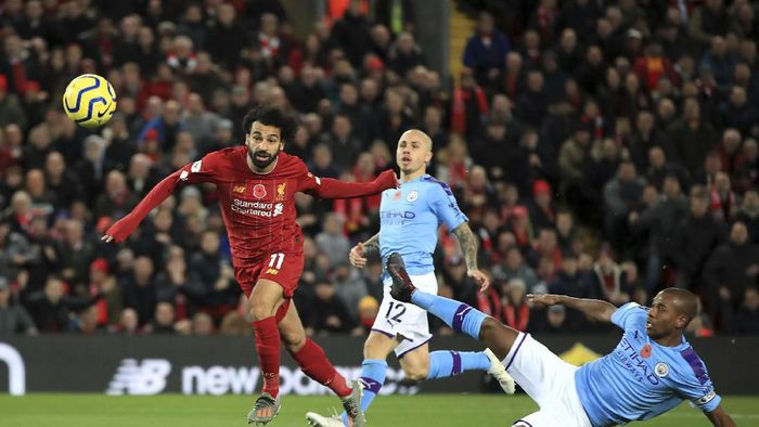 Liverpools Mohamed Salah, left, celebrates after scoring his sides second goal during the English Premier League soccer match between Liverpool and Manchester City at Anfield stadium in Liverpool, England, Sunday, Nov. 10, 2019. (AP Photo/Jon Super)