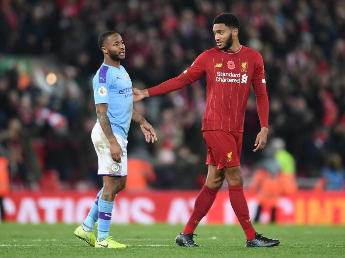 LIVERPOOL, ENGLAND - NOVEMBER 10:  Raheem Sterling of Manchester City speaks with Joe Gomez of Liverpool following the Premier League match between Liverpool FC and Manchester City at Anfield on November 10, 2019 in Liverpool, United Kingdom. (Photo by Laurence Griffiths/Getty Images)