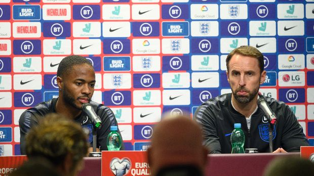 England's manager Gareth Southgate (R) and England's forward Raheem Sterling address a press conference at the Sinobo Arena in Prague, on October 10, 2019, the eve of the UEFA Euro 2020 qualifier Group A football match Czech Republic v England.JOE KLAMAR / AFP