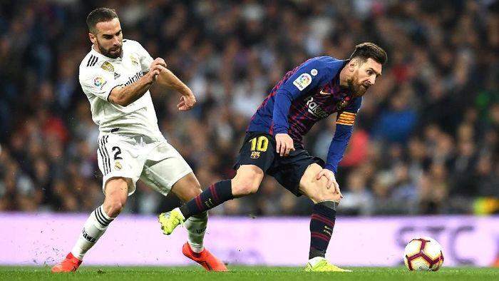 Bek Real Madrid Dani Carvajal mengaku senang jika Barcelona gagal di musim ini. (Foto: David Ramos / Getty Images)