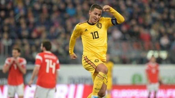 Eden Hazard mencetak dua gol untuk membawa Belgia menang 4-1 atas Rusia (Foto: Olga MALTSEVA / AFP)